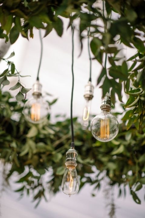 Greenery and Edison Bulb Chandelier | Sean Money + Elizabeth Fay Photography | See More! https://heyweddinglady.com/farm-table-luxe-organic-wedding-inspiration/