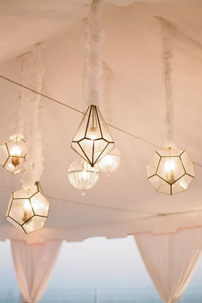 Geometric Gem Pendant Lights in a Blush Wedding Canopy | Elizabeth Messina Photography | See More! https://heyweddinglady.com/glamorous-geometric-wedding-inspiration-in-fuchsia-blush-and-gold/