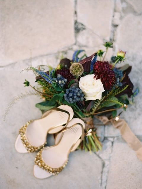 Gold Wedding Shoes and A Rich Blue and Burgundy Bouquet | Megan Pomeroy Photography | See More! https://heyweddinglady.com/farm-table-luxe-organic-wedding-inspiration/