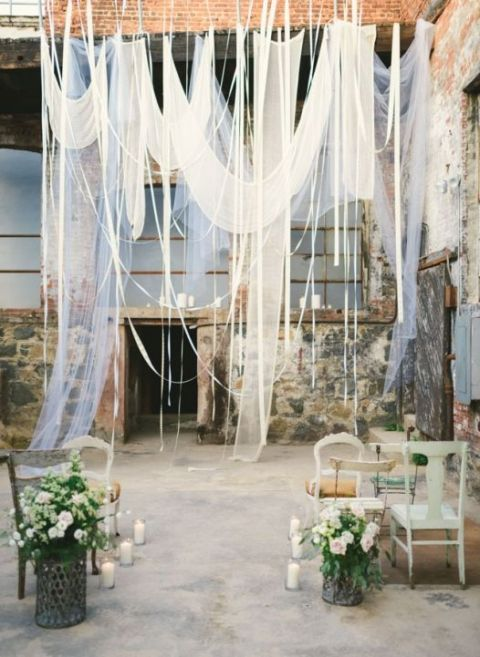 Romantic Industrial Loft Wedding Ceremony with Hanging Drapery | Kate Ignatowski Photography | See More! https://heyweddinglady.com/modern-garden-deconstructed-industrial-loft-wedding/