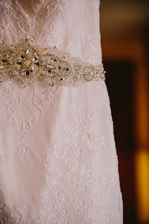 Romantic Lace Wedding Dress with a Crystal Sash for a Sweetly Opulent Black Tie Texas Wedding | PhotoHouse Films | See More! http://heyweddinglady.com/sweetly-opulent-black-tie-texas-wedding/