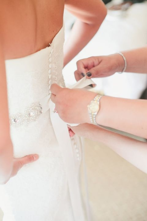 A Classic Lace wedding Dress and Crystal Sash | Onelove Photography | See More! https://heyweddinglady.com/pink-mint-and-gold-wedding-with-lots-of-sparkle/