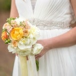 Yellow and Orange Ranunculus, Blush Rosebuds and Stock and White Peonies for a French Country Inspired Bouquet | Amy Allen Photography | See More! https://heyweddinglady.com/french-country-chic-wedding-style/