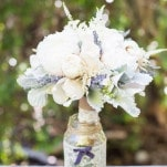 Romantic Rustic Bridal Bouquet in Cream and Purple with a Custom Wrap in Burlap and Lace from the Brides Dress | Dawn Heumann Photography | See More! https://heyweddinglady.com/romantic-bespoke-wedding-handmade-by-friends/