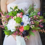 Colorful Bridal Bouquet in Green, Pink, Purple, and Blue | Nicole Marie Photography | See More! https://heyweddinglady.com/boho-brewery-wedding-inspiration-in-rich-jewel-tones/