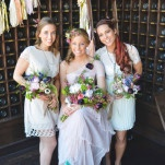 Bride in blush and the bridesmaids in ivory, gorgeous jewel toned flowers and a brewery backdrop! | Nicole Marie Photography | See More! https://heyweddinglady.com/boho-brewery-wedding-inspiration-in-rich-jewel-tones/