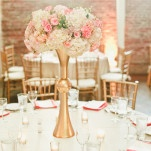 Modern Pink and White Centerpieces in Tall Gold Vessels | Onelove Photography | See More! https://heyweddinglady.com/pink-mint-and-gold-wedding-with-lots-of-sparkle/
