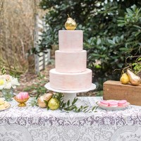 Marbled Wedding Cake Accented with Gold Leaf Pears and Pink Pastries | Amy Allen Photography | See More! https://heyweddinglady.com/french-country-chic-wedding-style/
