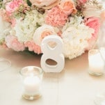 Pink and Ivory Centerpieces with Modern White Table Numbers | Onelove Photography | See More! http://heyweddinglady.com/pink-mint-and-gold-wedding-with-lots-of-sparkle/