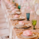 Pink Roses and Jewel Toned Glasses at Every Place Setting | PhotoHouse Films | See More! https://heyweddinglady.com/sweetly-opulent-black-tie-texas-wedding/