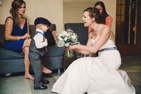 The Tiny Ring Bearer is Fascinated with the Brides Bouquet | Oldani Photography | See More! http://heyweddinglady.com/modern-chic-blue-white-and-silver-wedding