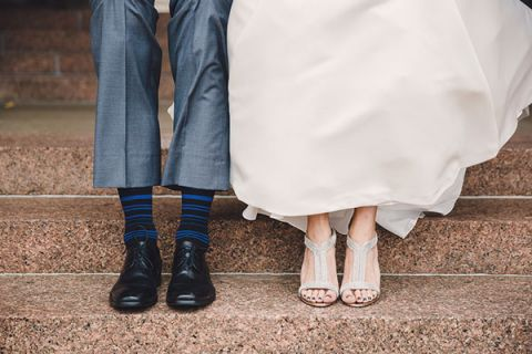 Showing Off their Wedding Shoes! Black and Blue Striped Socks for the Groom and Glam Silver Shoes for the Bride! | Oldani Photography | See More! http://heyweddinglady.com/modern-chic-blue-white-and-silver-wedding