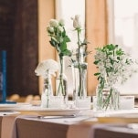 Simple White Floral Arrangements in Bud Vases | Oldani Photography | See More! https://heyweddinglady.com/modern-chic-blue-white-and-silver-wedding