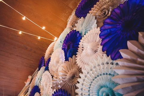 Blue and White Paper Pinwheel Wedding Backdrop | Oldani Photography | See More! http://heyweddinglady.com/modern-chic-blue-white-and-silver-wedding