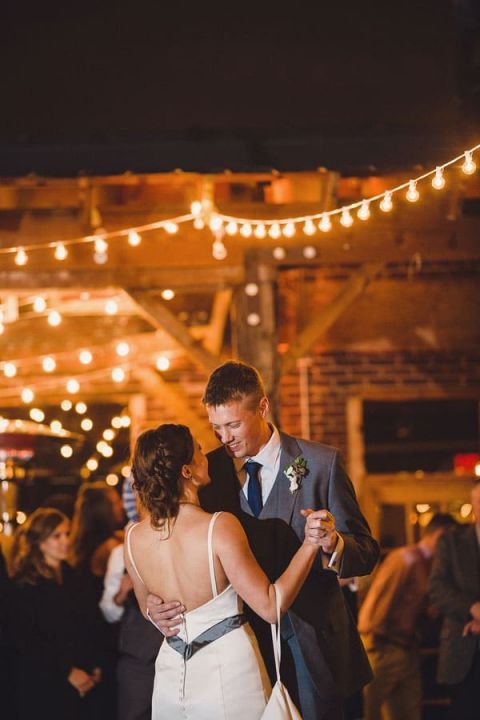 Romantic Bistro Lighting Overhead for the First Dance | Oldani Photography | See More! http://heyweddinglady.com/modern-chic-blue-white-and-silver-wedding