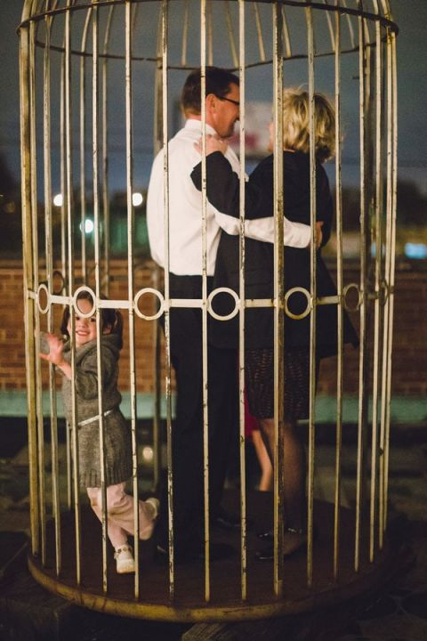 Cage Dancing Makes for Fun Wedding Portraits! | Oldani Photography | See More! http://heyweddinglady.com/modern-chic-blue-white-and-silver-wedding