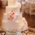 A Blush and Ivory Wedding Cake on a Crystal Stand | PhotoHouse Films | See More! https://heyweddinglady.com/sweetly-opulent-black-tie-texas-wedding/