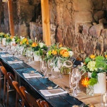 Farm Tables in Reclaimed Wood and Rustic Orange Decor for a Romantic Ranch Wedding | Lisa Mallory Photography | See More! https://heyweddinglady.com/autumn-harvest-wedding-at-santa-margarita-ranch/