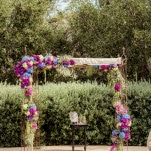 Wedding Ceremony Arbor with Purple and Blue Flowers | Figlewicz Photography | See More! https://heyweddinglady.com/classic-garden-wedding-in-rich-purple/