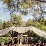 A Gorgeous Garden Wedding Ceremony in Purple and Blue with a Billowing Canopy | Figlewicz Photography | See More! https://heyweddinglady.com/classic-garden-wedding-in-rich-purple/