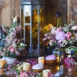 A Peach and Blush Floral Runner with Glowing Candles and Jewel Toned Lanterns | Nicole Marie Photography | See More! https://heyweddinglady.com/boho-brewery-wedding-inspiration-in-rich-jewel-tones/