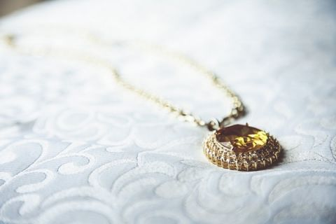 Gold Topaz Wedding Pendant | Bonnallie Brodeur Photography | See More! https://heyweddinglady.com/luxurious-multicultural-wedding-in-red-and-gold/