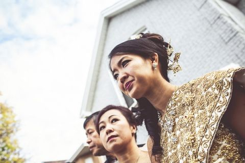 Traditional Cambodian Bridal Attire | Bonnallie Brodeur Photography | See More! https://heyweddinglady.com/luxurious-multicultural-wedding-in-red-and-gold/