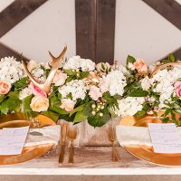 Lush Floral Table Runner with Blush and Ivory Flowers and Gold Antlers | Kirstyn Marie Photography | Relaxed Glam Southern Barn Wedding