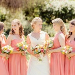 Bridesmaids wore Mismatched Coral Dresses | Figlewicz Photography | Coral and Green Botanical Gardens Wedding