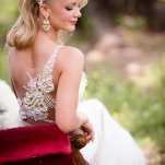 Stunning Illusion Back Wedding Dress on a Red Velvet Settee | Hauntingly Beautiful Vintage Bridal Portraits | Jamie Fender, Photographer