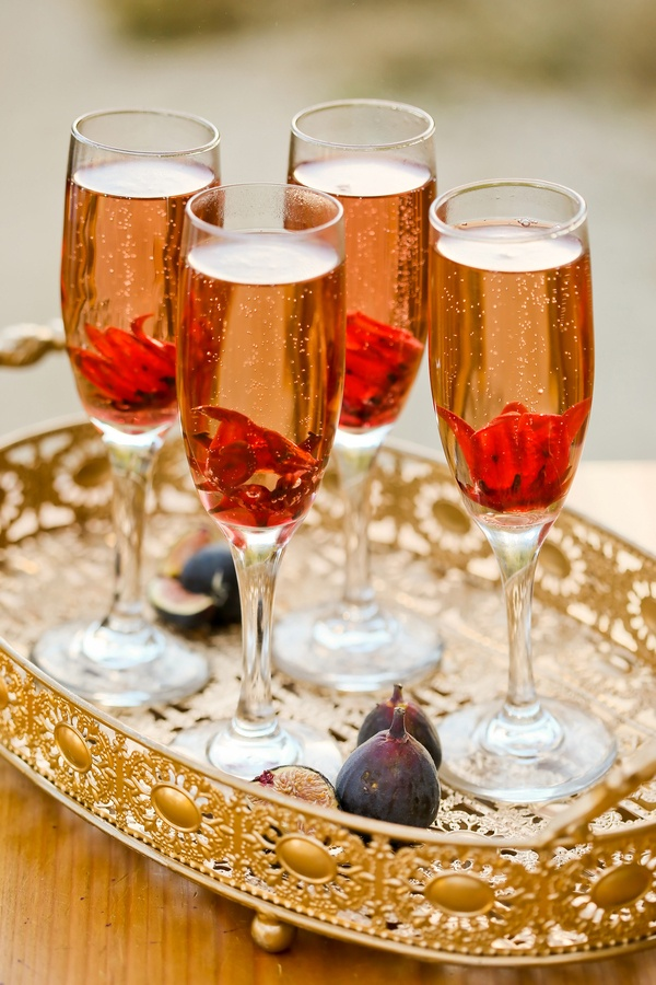 Pomegranate Champagne Cocktails | Modern Glam Autumn Wedding in Fig and Gold | Pepper Nix Photography and Michelle Leo Events