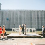 Modern Urban Wedding Ceremony on the River | Christina Laing Photography | Whimsical Urban Wedding in Aqua, Orange, and Yellow