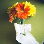 Simple and Cheerful Bouquet of Yellow and Orange Gerber Daisies | Christina Laing Photography | Whimsical Urban Wedding in Aqua, Orange, and Yellow