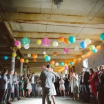 First Dance in a Urban Downtown Loft with Colorful Lanterns | Christina Laing Photography | Whimsical Urban Wedding in Aqua, Orange, and Yellow