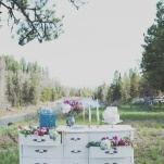 Gorgeous Wedding Cake Display on a Vintage Bureau | Ellie Asher Photo | Dreamy Mountain Lodge Wedding in Fuchsia and Mint
