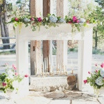 Flower and Eucalyptus Adorned Mantel for a Romantic Wedding Ceremony | Ellie Asher Photo | Dreamy Mountain Lodge Wedding in Fuchsia and Mint