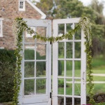 Vintage Farm House Doors for a Country Wedding Ceremony Backdrop   Kirsten Smith Photography   English Inspired Country Club Wedding in Purple and White