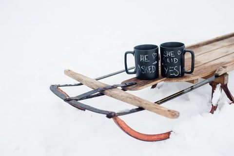 A Sled and Chalkboard Mugs for a Winter Engagement | Imago Dei Photography | Warm and Cozy Snowfall Engagement Portraits