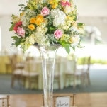 Tall Pink and Yellow Centerpieces | Inspired Photography by Susie & Becky | Stylish Blue & Yellow Country Manor Wedding with a Superhero Theme!