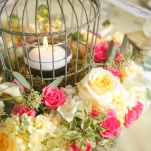 Pink and Yellow Rose Wreath Around a Votive Lantern | Inspired Photography by Susie & Becky | Stylish Blue & Yellow Country Manor Wedding with a Superhero Theme!