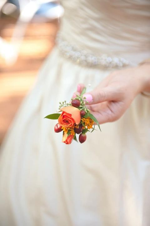 Boutonniere with Orange Roses and Berries | Bit of Ivory Photography | Traditional Autumn Wedding in Eggplant and Orange