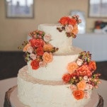 Orange and Peach Roses on a Simple Wedding Cake with a Tree Trunk Stand | Bit of Ivory Photography | Traditional Autumn Wedding in Eggplant and Orange