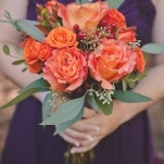 Bridesmaid Bouquet with Ruffled Orange Roses and Eucalyptus | Bit of Ivory Photography | Traditional Autumn Wedding in Eggplant and Orange