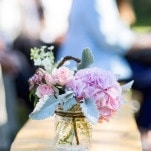 Peony Aisle Arrangements on Rustic Benches | J. Harper Photography | Elegant Farm Wedding in Pastels and Gold Glitter