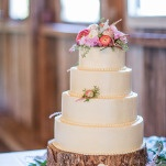 A Romantic Pastel Wedding Cake on a Tree Stump | J. Harper Photography | Elegant Farm Wedding in Pastels and Gold Glitter