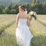 Romantic Bohemian Bride Surrounded by Lavender | Ashley Cook Photography | Vintage Lace, Sunshine, and Lavender Fields Wedding Styled Shoot