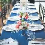 Coral Rose Centerpieces in Silver Julep Cups | Shannon Moffit Photography | Classic and Elegant Navy Blue and Coral Nautical Wedding