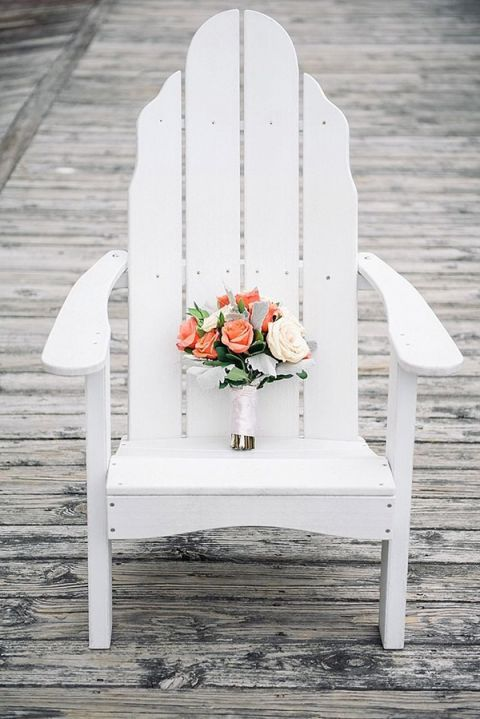 Coral and Ivory Bouquet on an Adirondack Chair | Shannon Moffit Photography | Classic and Elegant Navy Blue and Coral Nautical Wedding