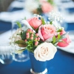 Petite Centerpieces with Roses and Berries | Shannon Moffit Photography | Classic and Elegant Navy Blue and Coral Nautical Wedding