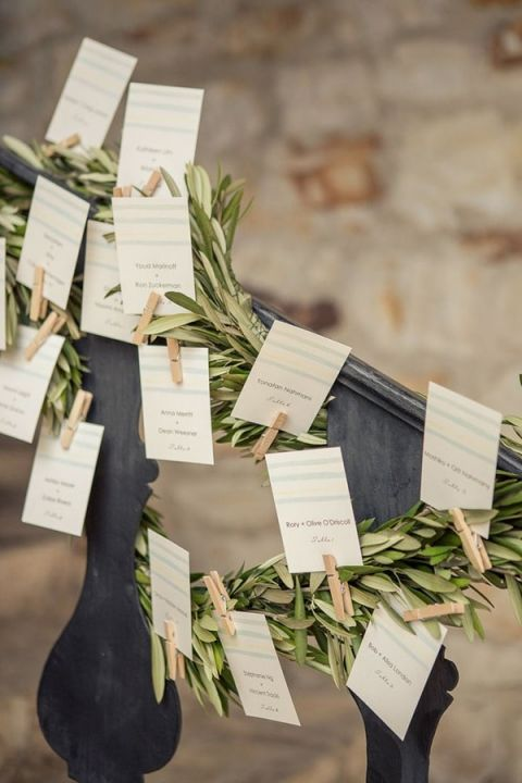 Greenery Garland Escort Cards | Carlie Statsky Photography | Light and Shadow - Still Life Inspired Fine Art Wedding Styling in Moody Winter Shades